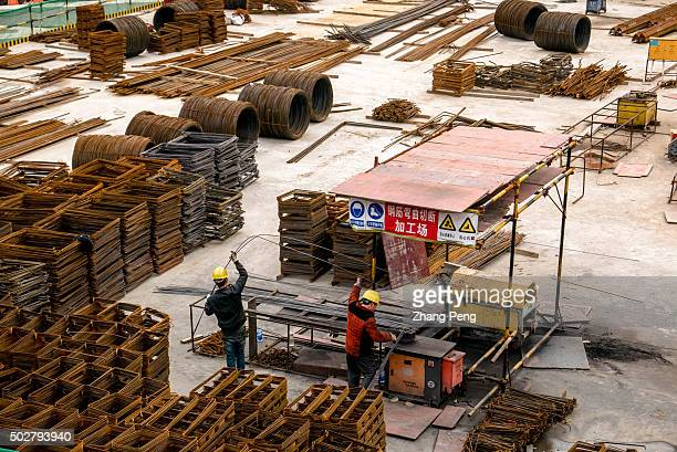 Iron and steel materials on a construction site China might introduce more easing policies in 2016 to consume unsold home inventories The country's...