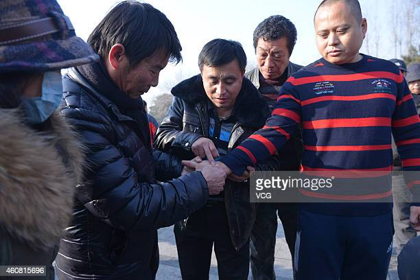 Iron Belly man Guo Haijun invites onlookers to punch him in the stomach on December 23 2014 in Shenyang Liaoning province of China