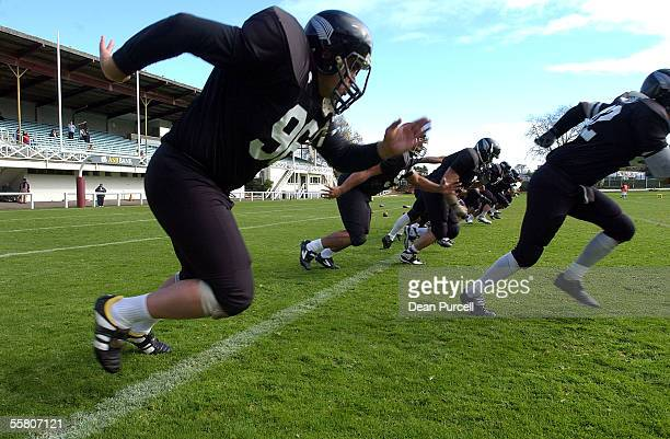 Iron Black Defensive Lineman Adrian Smith warms up with his team before the American Football match between the New Zealand Iron Blacks and Australia...