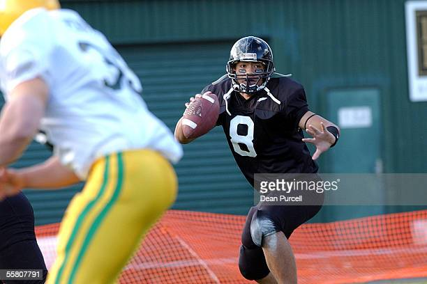 Iron Black Quarterback Joseph Toilolo looks for space to pass during the American Football match between the New Zealand Iron Blacks and Australia...