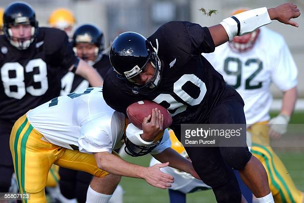 Iron Black Runningback Lee Penu crashes into the Australian defence during the American Football match between the New Zealand Iron Blacks and...