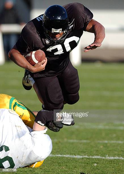 Iron Blacks Runningback Lee Penu flys over Australia's Tom Kinloch during the American Football match between the New Zealand Iron Blacks and...