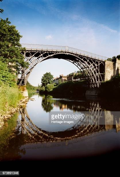 Iron Bridge Ironbridge Gorge Shropshire circa 1980circa 2017 View of the bridge looking down the River Severn with reflections shown in the water...