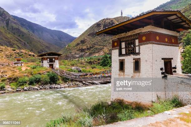 iron bridge of tamchog lhakhang monastery, paro river, bhutan. - ipek morel stock pictures, royalty-free photos & images