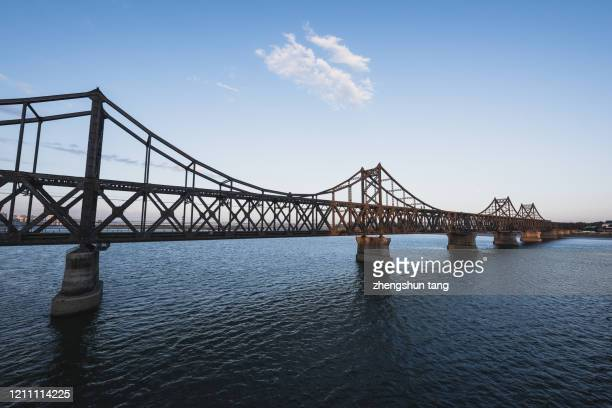 iron bridge of ya lv river - dandong stock pictures, royalty-free photos & images