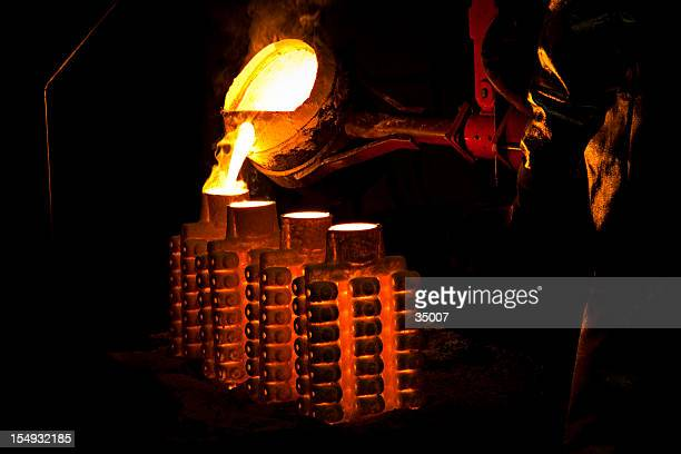 iron casting - steelmaking stock photos and pictures