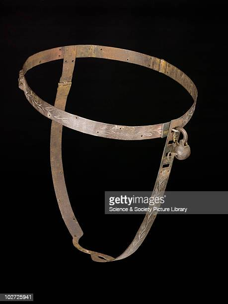 Iron chastity belt complete with padlock Iron chastity belt complete with padlock Front view of whole obejct against black background