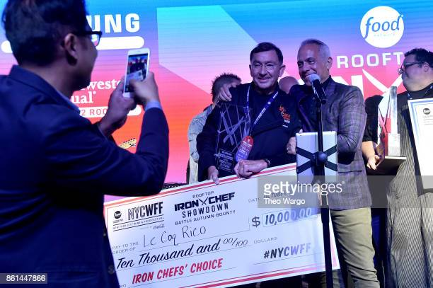 Iron Chefs' Choice winner Antoine Westermann of Le Coq Rico poses with Geoffrey Zakarian the Food Network Cooking Channel New York City Wine Food...