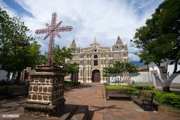 iron cross in front of church - antioquia stock pictures, royalty-free photos & images