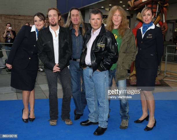 Iron Maiden band members Adrian Smith Nicko McBrain Bruce Dickinson and Janick Gers arrive at the 'Iron Maiden Flight 666' UK premiere at Odeon South...