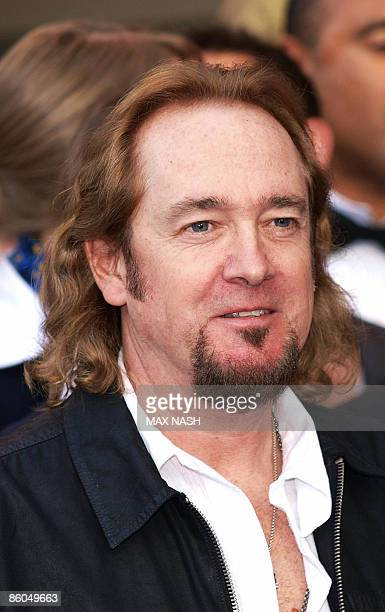 Iron Maiden guitarist Adrian Smith arrives in Kensington London to attend the premiere of the film Flight 666 made about the group on April 20 2009...
