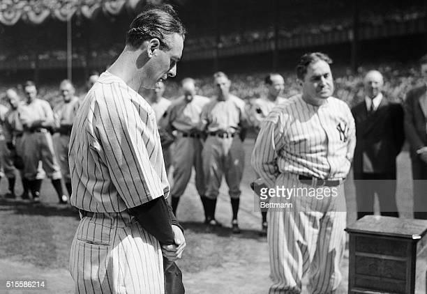 Iron man Lou Gehrig first baseman for the Yankees whom sickness benched stands with his head bowed as tears well into his eyes during the ceremonies...