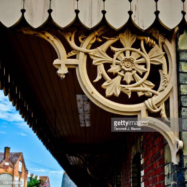 iron motif at sheringham railway station norfolk - bavosi stock pictures, royalty-free photos & images