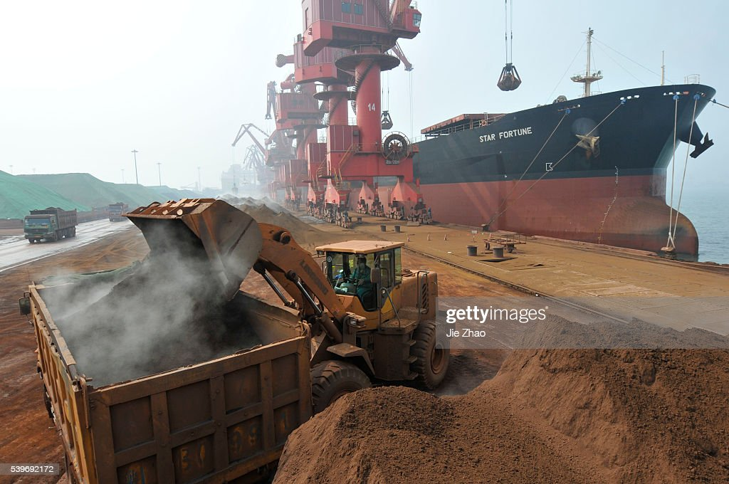 Iron ore from Australia is unloaded at Rizhao Port, one of China's biggest ports for importing the commodity, Shandong p : News Photo
