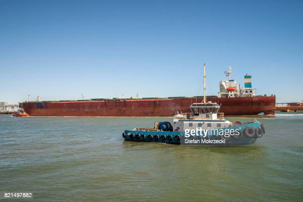 Iron Ore Ship And Tugboat Port Hedland, Australia