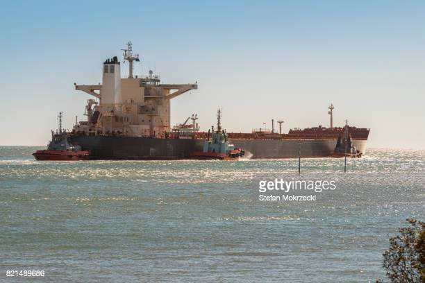 Iron Ore Ship And Tugboats Leaving Port Hedland, Australia