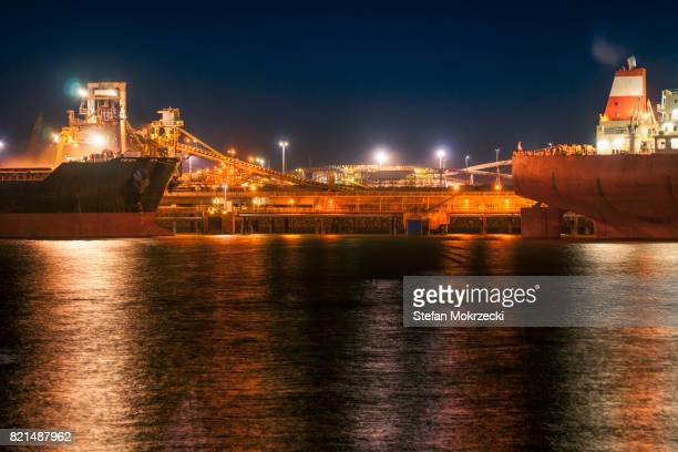 Iron Ore Ships And Loading Machinery At Night, Port Hedland, Australia