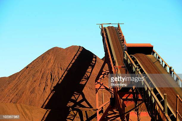 Iron ore travels via conveyor belts on stackers to form stockpiles at Atlas Iron Ltd's Pardoo mine site in Pardoo east of Port Hedland in the Pilbara...
