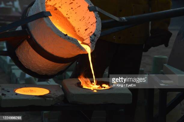 iron pour of molten hit iron. - metal stock pictures, royalty-free photos & images