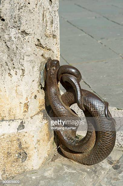 Iron ring in snake form to tie on horses on a post on the Piazza del Campo in Siena, Tuscany, central Italy.