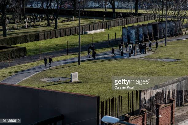 Iron steles and remains of the wall show the course of the former border at the Berlin Wall memorial at Bernauer Strasse on February 5 2018 in Berlin...