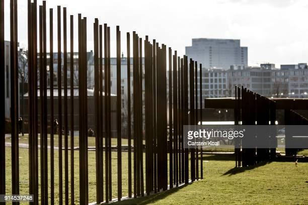 Iron steles symbolize the course of the former border at the Berlin Wall memorial at Bernauer Strasse on February 5 2018 in Berlin Germany Today has...