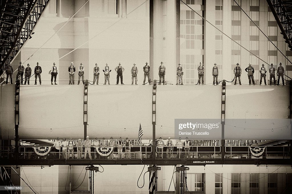 Image has been converted to black and white.) Iron workers employed by American Bridge (Top Row L-R) Ugo Del Costello, Robert Conway, James McCullough, Stuart Shew, Shawn McClelland, Cory Zobrist, Thomas Pype, Slade Boyd, Robert Fitz, Robert Horton, Ryan Sloan, Seth Wilson, Curns Moore, Michael Scales, Trevor Burgess, Joseph Landis, Chaz Woods, J.J. Trujillo, Joshua Horn, Bruce Barkovich and George McManus (Bottom Row L- R ) Jason Faltinowski, Jason Broderdorf, Austin White, Rob McDonald, Lance Pierce, Dan Radu, Lou Wehar, Mike Cegelis, Jeremiah Beiter, John Callaghan, Dan Schwarz, Tim Popham, Simon Laming and James Dipasquale stand across the hub and spindle of Caesars Entertainment's High Roller, a 550-foot tall observation wheel taking shape on the Las Vegas Strip and redefining the iconic Las Vegas skyline. The largest observation wheel in the world, the High Roller will be the focal point of The LINQ, a $500 million open-air retail, dining and entertainment district on August 30, 2013 in Las Vegas, Nevada.