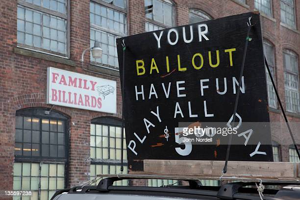 ironic sign of the economic times outside family billiards in north adams, ma - bailout stock pictures, royalty-free photos & images