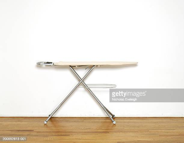 Ironing board on wooden floor, close-up