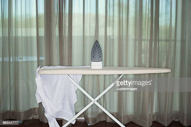 Ironing board with iron and shirt