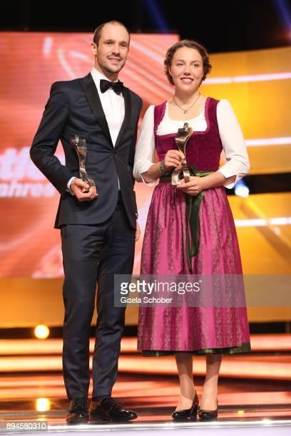 Ironman winner 2017 Patrick Lange and Biathlete Laura Dahlmeier with award during the 'Sportler des Jahres 2017' Gala at Kurhaus BadenBaden on...