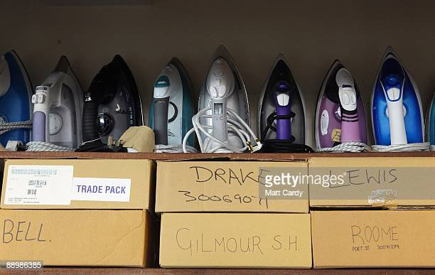 Irons belonging to Royal Navy recruits in week seven of their nine-week course are lined up at the training establishment HMS Raleigh, as another...