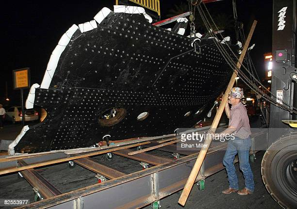 Ironworker Craig Pilley works on moving the largestever recovered piece of the Titanic into the Luxor Resort Casino August 26 2008 in Las Vegas...