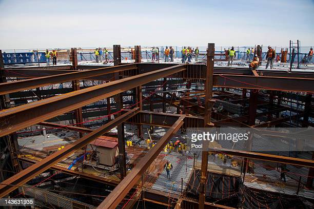 Ironworkers weld steel decking at the top of One World Trade Center on the day it became New York City's tallest skyscraper April 30 2012 in New York...