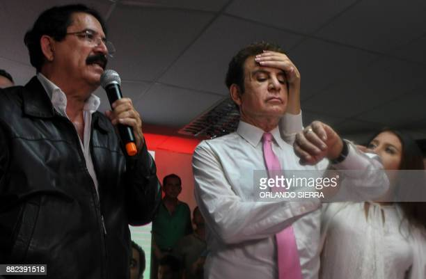 Iroshka Elvir de Nasralla wipes the forehead of her husband Salvador Nasralla the presidential candidate for Honduras' Opposition Alliance against...