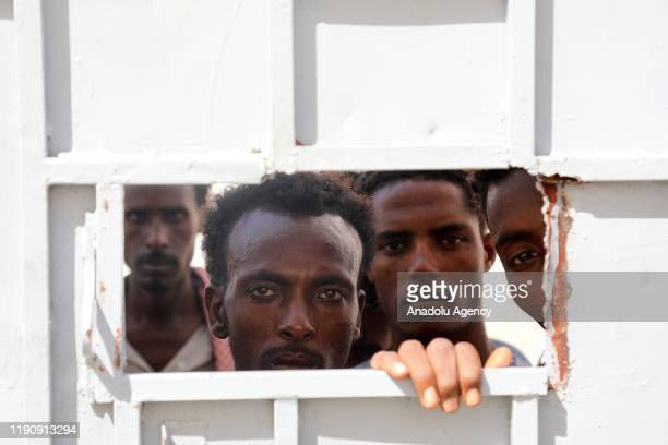 Irregular African migrants are seen at a prison in Taizz, Yemen on December 25, 2019. Irregular migrants, arrested for illegal entry into Yemen, have...
