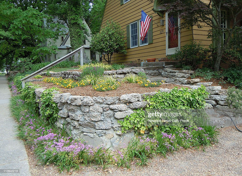 Irregular Chunks Of Concrete Form A Retaining Wall Steps And