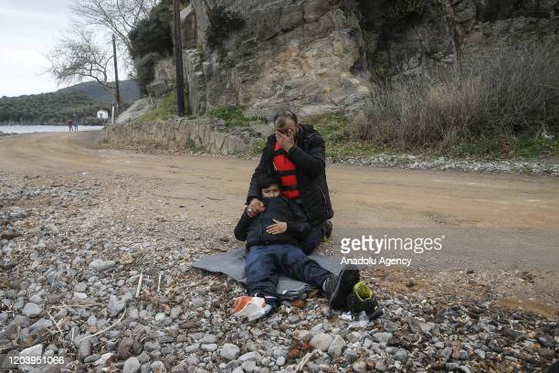 Irregular migrants escaped from civil war in Syria, who want to proceed to Europe, are seen after they came with a boat at a shore in Lesbos Island...