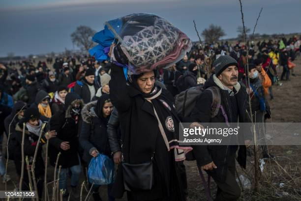 Irregular migrants gather at the land border between Greece and Turkey, Karaagac neighbourhood in Edirne, Turkey to reach Greece on March 01, 2020....