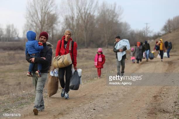 Irregular migrants march towards Evros River to cross Turkey's border with Greece in Edirne, Turkey on February 29, 2020. Irregular migrants,...