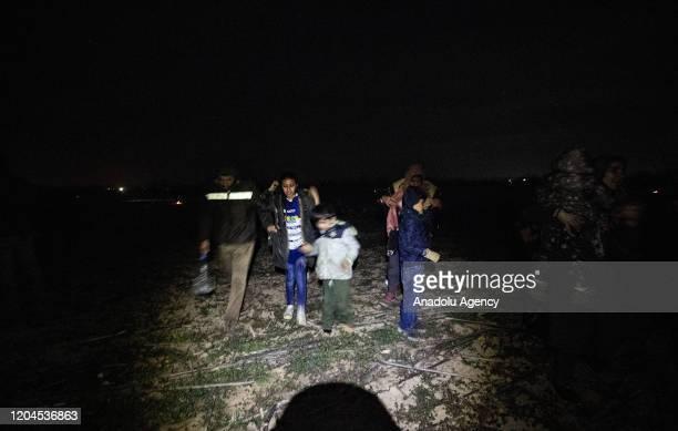 Irregular migrants run away from tear gas smokes launched by Greek border guards at the land border between Greece and Turkey, Karaagac neighbourhood...