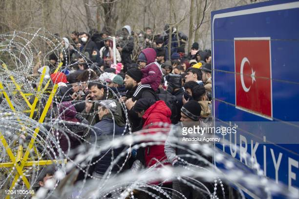 Irregular migrants wait at Pazarkule Border Gate to enter Greek side for reaching Europe, at Turkey's border with Greece in Edirne, Turkey on...