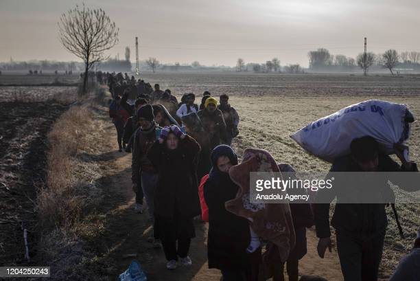 Irregular migrants walks at fields as they head to Pazarkule Border Gate to enter Greek side for reaching Europe, at Turkey's border with Greece in...