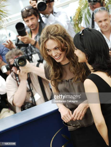 Irrfan Khan and Angelina Jolie during 2007 Cannes Film Festival 'A Mighty Heart' Photocall at Palais des Festivals in Cannes France