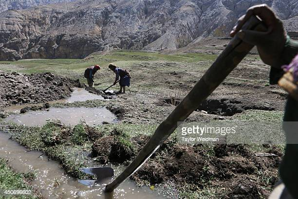 Irrigated water from snow melts is used to make mud bricks for construction projects in Dhe village. Dhe village has been facing an acute water...