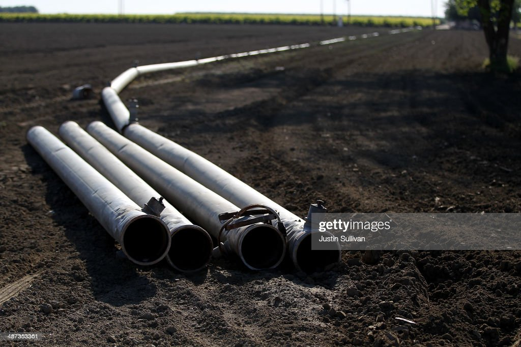 Irrigation pipes are shown arranged on a farm on April 29, 2014 near Mendota, California. As the California drought continues, Central California farmers are hiring well drillers to seek water underground for their crops after the U.S. Bureau of Reclamation stopped providing Central Valley farmers with any water from the federally run system of reservoirs and canals fed by mountain runoff.