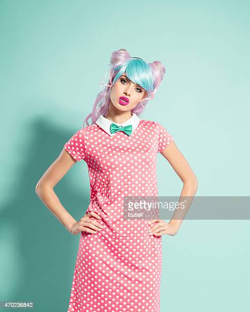 irritated pink hair manga style girl - pink dress stock photos and pictures