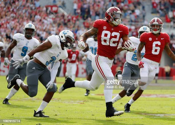 Irv Smith Jr #82 of the Alabama Crimson Tide breaks away with a reception on the way to a touchdown against Joshua Bowers of the Citadel Bulldogs at...