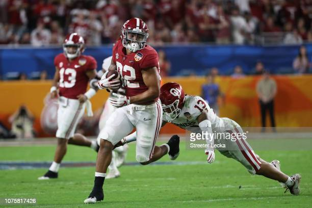 Irv Smith Jr #82 of the Alabama Crimson Tide carries the ball against the Oklahoma Sooners during the College Football Playoff Semifinal at the...