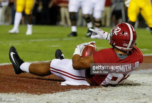 Irv Smith Jr #82 of the Alabama Crimson Tide reacts after catching a touchdown reception against the LSU Tigers at BryantDenny Stadium on November 4...